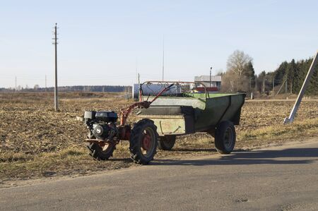 Tractor farmer on the basis of two-wheel tractor photo