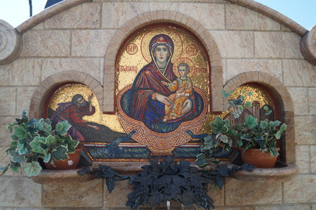 sacred source: Face of the Mother of God in the holy spring Stock Photo