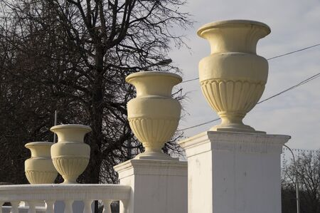 vase plaster: Large decorative pots on the railing of the bridge