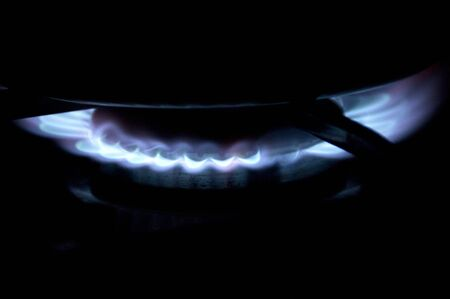 gas cooker: Blue spark of a torch of a gas cooker Stock Photo