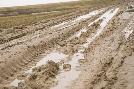 unpaved road: Unpaved country road blurred by rain Stock Photo