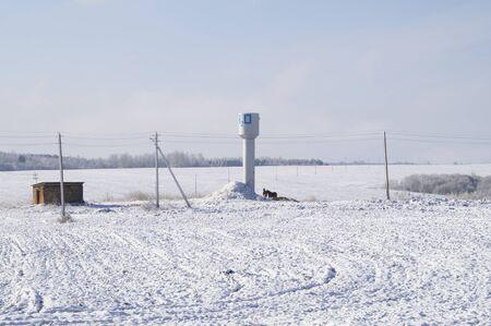 snowy field: a water tower on a snowy field