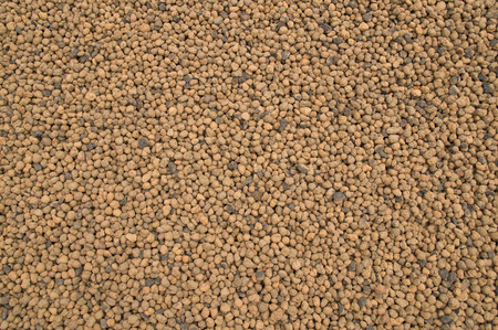 size distribution: Background image of brown beads small Stock Photo