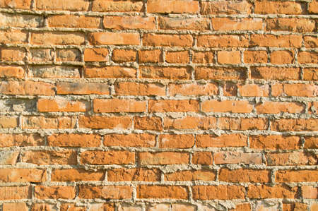 chipping: Old brick wall of red brick