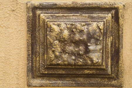 19th: Decorative items made of bronze on the wall of a 19th century