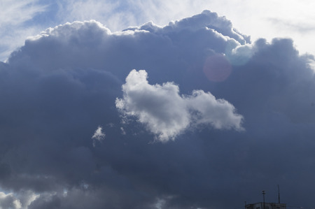manifestations: Beautiful, white cloud on a background of blue clouds