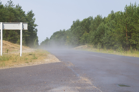 evaporation: evaporation on a hot summer day on the asphalt after the rain Stock Photo