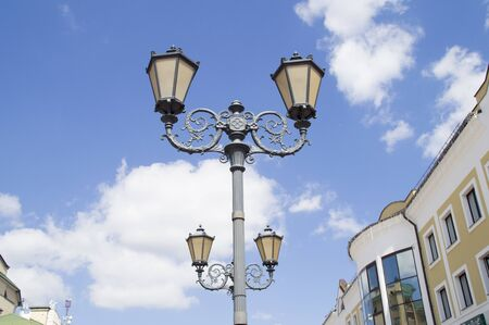 19th century style: Street lighting lantern with 19th-century style on a background of blue sky