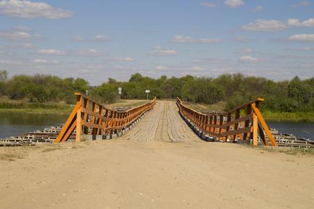 pontoon: The temporary pontoon bridge across the river