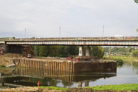 throughput: Construction of a road bridge over the river in the city