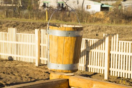 dug well: wooden bucket old well