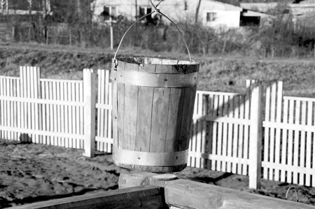 dug well: wooden bucket in the well