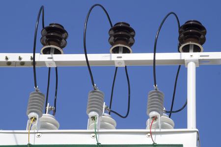 busbar: porcelain insulators of high-voltage substation on blue sky