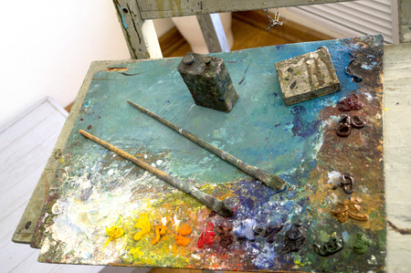 air dried: paint, brushes and easel painter Stock Photo