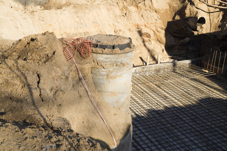 sewage system: well installation receiving sewage Stock Photo