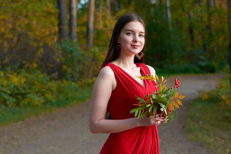 Girl in red dress in the woods