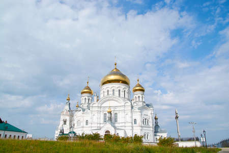 the Belogorsky monastery on the background of blue sky with clouds