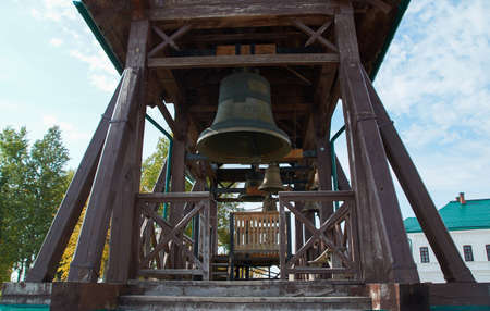 The bells of the Belogorsky monastery on the background of summer blue sky.