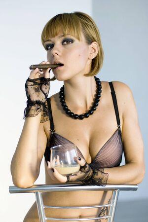 beauty woman smoking cigar photo