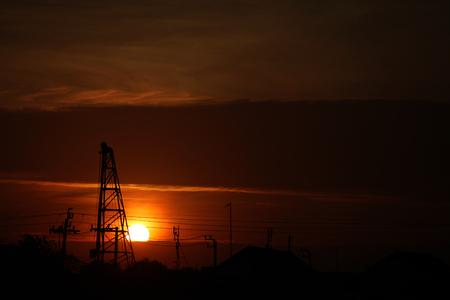 Black shadow construction cranes with orgnge sky background and sunset, silhouette , landscape