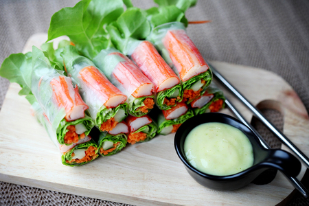 Fresh salad rolls with crab on wood plate 写真素材