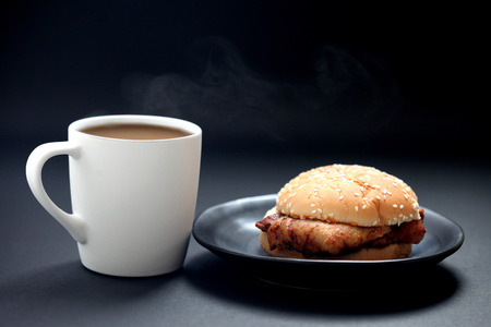 Chicken Burger and hot coffee on black background , close up 写真素材
