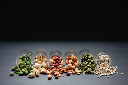 Mix Nut in the glass on black background , close up , peanut; Peas; Sunflower seeds; Pumpkin seeds; cashew nuts; pistachios 写真素材