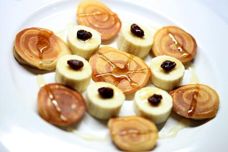 Banana pancakes on white dish , close up , macro 写真素材