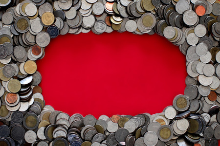 Thai baht coin on red background with copy space