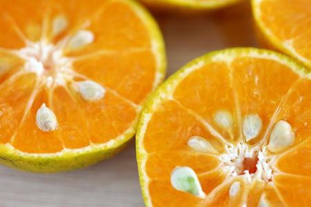 Fresh half orange on wooden background 写真素材