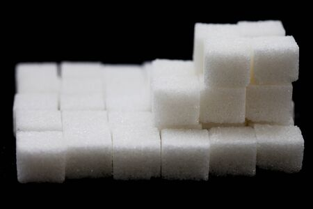 Sugar cubes on black background , close up , macro