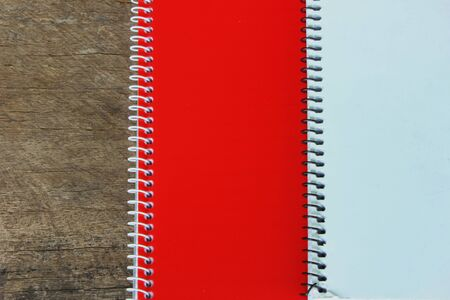 Red notebook on white photo