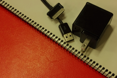 Notebook battery charge with the phone Stock Photo - 16217788