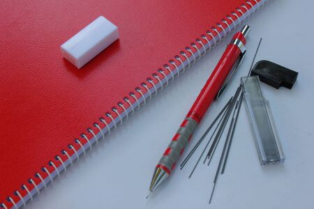 Red notebook and Mechanical pencil with pencil lead ,Eraser  Stock Photo - 16217795