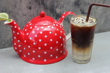 Red kettle with coffee photo