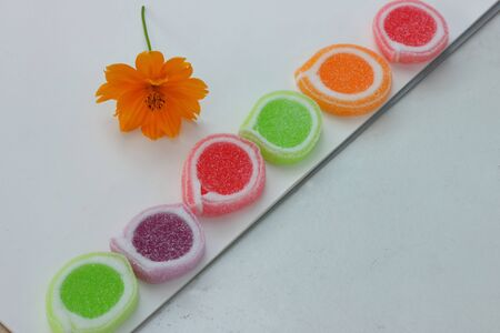 Colorful candy with flowers  photo