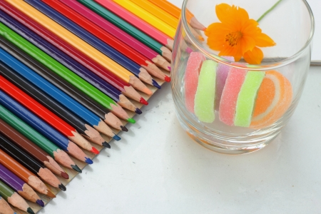 Colorful crayons and candy  photo