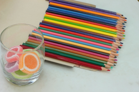 Colorful crayons and candy  Stock Photo - 16303695
