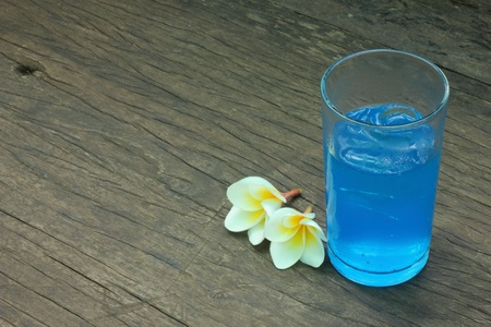 spilt: Soda drinks with blue flowers  Stock Photo