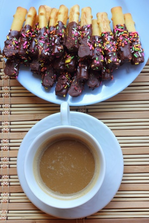 Biscuits coated chocolate and hot coffee photo