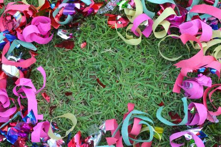 Scrap ribbon on green grass  photo