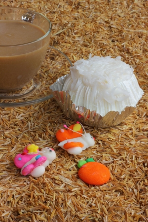 Coconut cake and hot coffee photo