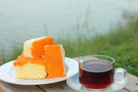 Butter cake and hot tea  photo