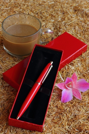 clericalist: Pen and hot coffee husk laying on the ground