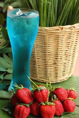 Fruit Strawberry berries on blue water -Onion  photo