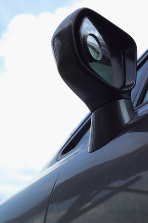 Car side mirror - sky. photo