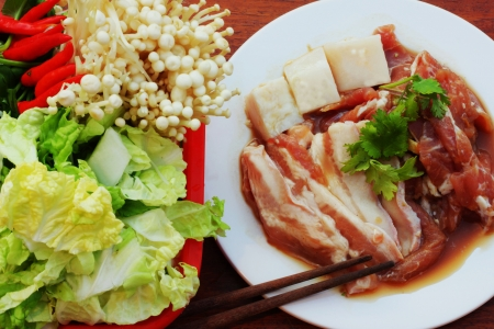 For grilled marinated pork with fresh vegetables  photo