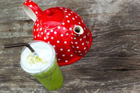 Cold green tea and red pot photo