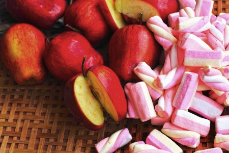 marshmellow: Fruit apple red with pink marshmellows. Stock Photo