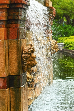 Waterfall in the garden - a lions head statue.